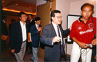 C.K.MA: ORIENTAL PRESS GROUP: HONG KONG<br /> <br />  C.K.Ma (2nd from right) leaves a press conference of O.D.N. publishing group.