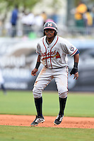 Mississippi Braves shortstop Elmer Reyes (14) leads off first during a game against the Montgomery Biscuits on April 22, 2014 at Riverwalk Stadium in Montgomery, Alabama.  Mississippi defeated Montgomery 6-2.  (Mike Janes/Four Seam Images)