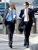 United States President Barack Obama walks and talks with traveling aide Bobby Schmuck , right, as he departs departs Walter Reed National Military Medical Center in Bethesda, Maryland on Tuesday, July 29, 2014 following a visit to wounded service members.  Earlier in the day, the President made a statement at the White House concerning additional sanctions on Russia for their involvement in Ukraine.  <br /> Credit: Ron Sachs / Pool via CNP