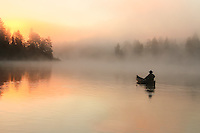 &quot;Foggy Glow&quot;<br /> Dramatic wilderness mornings deliver mystery with the tranquil fog and promise a sunny day ahead. Paddling through a stunning scene in the Boundary Waters is a surreal and enriching experience.<br /> <br /> This photograph is from our Canoescapes Series.