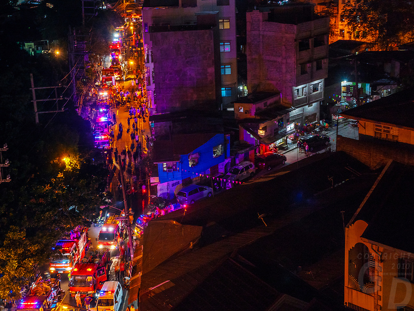 Manila, Philippines Fire tracks attending to a large fire at night, Manila, Philippines