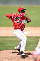 Batavia Muckdogs pitcher Alexander Carreras (43) delivers a pitch during a game against the Lowell Spinners on July 17, 2014 at Dwyer Stadium in Batavia, New York.  Batavia defeated Lowell 4-3.  (Mike Janes/Four Seam Images)