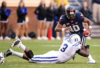 Virginia quarterback Jameel Sewell (10) is sacked by Duke defensive tackle Vince Oghobaase (3) during an ACC football game Saturday in Charlottesville, VA. Duke won 28-17. Photo/Andrew Shurtleff