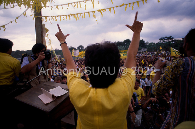 Manila, Philippines<br /> February 1986<br /> <br /> Corazon Aquino campaigning for President of the Philippines in 1986.<br /> <br /> Corazon Aquino was born into one of the wealthiest families in the Philippines, Mrs. Aquino began her political education by playing the dutiful wife as the political career of her husband, Benigno Aquino Jr., expanded. In less than 20 years he emerged as one of the chief potential rivals of Mr. Marcos, who was then president. When Mr. Marcos declared martial law in 1972, her husband was arrested and imprisoned for seven years. He was assassinated in 1983 after returning to the Philippines from a three-year exile in the United States. Mr. Marcos was widely blamed for the murder. It was at Mr. Aquino's funeral that Mrs. Aquino, became a national symbol, demonstrating the dignity and composure that would characterize her most difficult moments as president. <br /> <br /> Mrs. Aquino came to power through what amounted to popular acclaim -- what the Philippino people called &quot;people power&quot; -- expressed by huge crowds that gathered in support of her. Her popularity reached its peak during her presidential campaign against Mr. Marcos in January 1986, when she was surrounded by enthusiastic crowds chanting, &quot;Cory! Cory! Cory!'&quot;<br /> <br /> Her act of knocking down a dictator and bringing democracy to the Philippines was a high point in the country's modern history, and it offered a model for nonviolent uprisings that has been repeated often in other countries.<br /> <br /> Mrs. Aquino, was often criticized as an indecisive and ineffectual leader. But she combined passivity and stubbornness and an unexpected shrewdness to hold firm against powerful opponents from both the right and the left, and one of her greatest accomplishments as president was fending off a half dozen coup attempts. <br /> <br /> The restoration of democracy, and the transition to a new president, were Mrs. Aquino's prime legacies. Yet she led demons