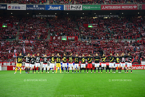 Urawa Reds team group,.MARCH 9, 2013 - Football / Soccer :.Urawa Reds players wear t-shirts with one letter each as they celebrate with fans after the 2013 J.League Division 1 match between Urawa Red Diamonds 1-0 Nagoya Grampus Eight at Saitama Stadium 2002 in Saitama, Japan. (Photo by AFLO)