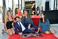 LOS ANGELES, CA. October 24, 2019: Harry Connick Jr., Georgia Connick, Sarah Kate Connick, Jill Goodacre & Charlotte Connick at the Hollywood Walk of Fame Star Ceremony honoring Harry Connick Jr.<br /> Pictures: Paul Smith/Featureflash
