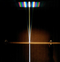 WHITE LIGHT PASSES THROUGH A DIFFRACTION GRATING. Diffraction Of White Light Forms A Spectrum. A single slit of white light passes through a diffraction grating to create a spectral Fraunhofer diffraction pattern.