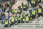 Stockholm 2015-05-25 Fotboll Allsvenskan Djurg&aring;rdens IF - AIK :  <br /> Poliser framf&ouml;r Djurg&aring;rdens supportrar under ett br&aring;k med AIK:s supportrar efter matchen mellan Djurg&aring;rdens IF och AIK <br /> (Foto: Kenta J&ouml;nsson) Nyckelord:  Fotboll Allsvenskan Djurg&aring;rden DIF Tele2 Arena AIK Gnaget supporter fans publik supporters slagsm&aring;l br&aring;k fight fajt gruff polis