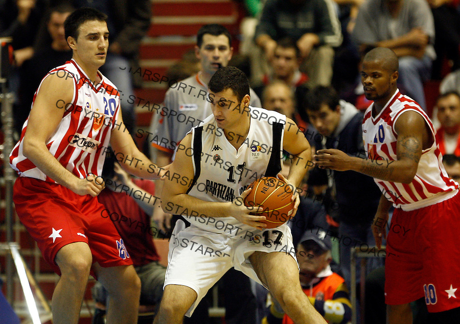 Kosarka.Partizan Vs. Crvena Zvezda.Marko Djurkovic, center, Tadija dragicevic, left and Omar Cook, right.Beograd, 03.11.2007..foto: Starsport