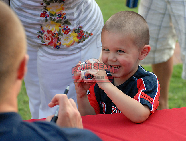 Henry Jones, 3, of Greenville, gets autographs at the 2010 South Atlantic League All-Star Game welcome party and festivities Monday night June 21, 2010, at the Wyche Pavilion along the Reedy River in Greenville, S.C. Photo by: Tom Priddy/Four Seam Images