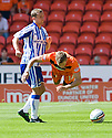DUNDEE UTD'S BARRY DOUGLAS IS FOULED BY KILMARNOCK'S JAMES FOWLER