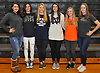 Six student-athletes from Mt. Sinai High School donning attire from the colleges of their respective future women's lacrosse teams pose for a group portrait in the school's gym on Wednesday, Nov. 8, 2017. Appearing are, from left, Sienna Masullo - Pace, Meaghan Scutaro - Notre Dame, Camryn Harloff - Stony Brook, Kirsten Scutaro - Notre Dame, Meaghan Tyrrell - Syracuse and Emily Seiter - Jacksonville.