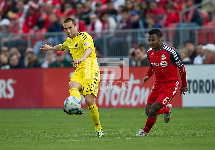 23 April 2011: Columbus Crew midfielder Dejan Rusmir #22 and Toronto FC midfielder Julian de Guzman #6 in action during a game between the Columbus Crew and the Toronto FC at BMO Field in Toronto, Ontario Canada..The game ended in a 1-1 draw.