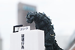Film character Godzilla bows in deep apology during a press conference on September 14, 2016, Tokyo, Japan. Japanese toy maker Bandai created a series of four monsters called the ''Godzilla Toho Monsters Press Conference'' marketed as vending machine capsule toys. The model monsters are bowing in front of a press stand expressing their formal apologies for acts of destruction in the country. They are on sale for 300 Yen (approx USD 2.92) each. (Photo by Rodrigo Reyes Marin/AFLO)