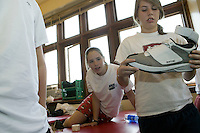 Schoolmates of Eric Boateng examine one of his shoes in the medical room of the gym at St Andrews High School in Middletown, DE, United States, 19 April 2005.