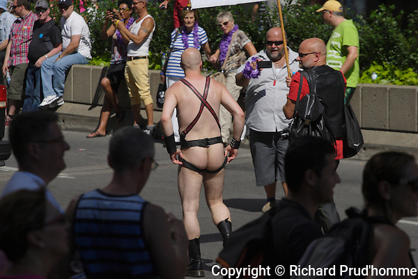 A male in leather participates in the Montreal Pride paradel
