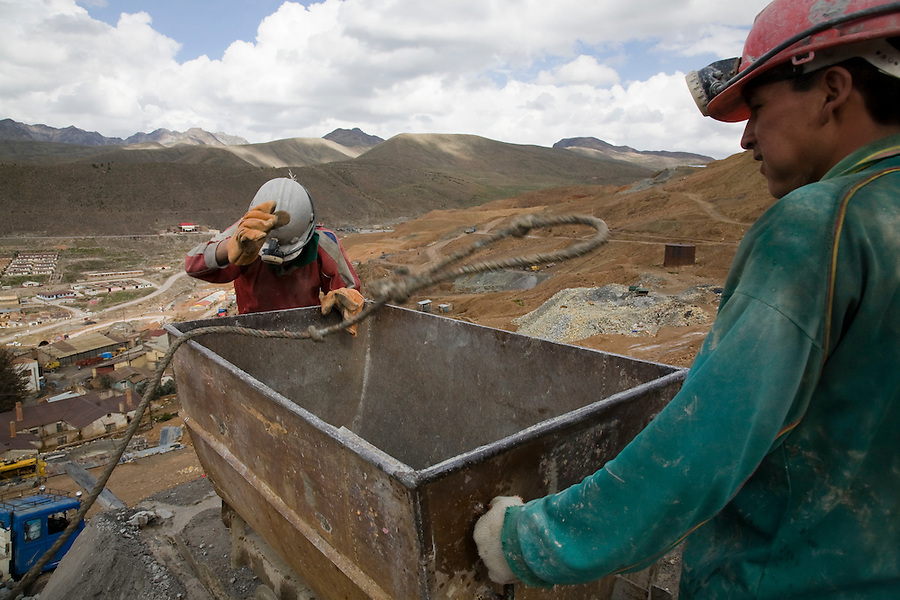 Miners emptying a trolley outside a mine on the Cerro Rico.