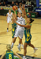 Ferns centre Kim Barnes shoots under pressure from Elizabeth Cambage during the International women's basketball match between NZ Tall Ferns and Australian Opals at Te Rauparaha Stadium, Porirua, Wellington, New Zealand on Monday 31 August 2009. Photo: Dave Lintott / lintottphoto.co.nz