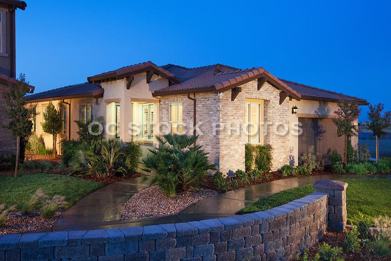 Single Story Home Exterior Dusk Stock Photo