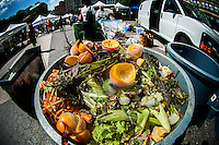 Compost collection at the Greenmarket in Union Square in New York on Friday, August 30, 2013. After a pilot program New York Mayor Michael Bloomberg has proposed mandatory composting requiring New Yorkers to separate items such as chicken bones and eggshells from the rest of their household trash. Opponents of the program, meant to reduce the amount of waste carted off to landfills, point out that most buildings in New York do not have the room for composting and the inevitable vermin problem that will go along with it. (© Richard B. Levine)