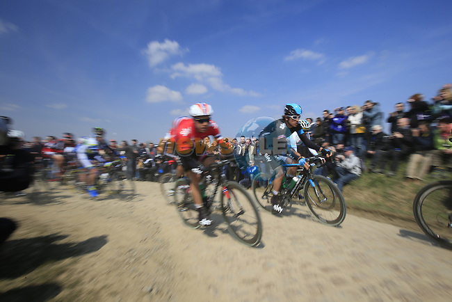 Riders including Edvald Boasson Hagen (NOR) and Geraint Thomas (WAL) Sky Procycling tackle pave section 25 of Quievy a Saint-Python during the 111th edition of the 2013 Paris-Roubaix cycle race, France 7th April2013 (Photo by Eoin Clarke 2013)