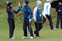 Naga Munchetty and Rachel Finnis celebrate on the 8th green during the Hero Pro-am at the Betfred British Masters, Hillside Golf Club, Lancashire, England. 08/05/2019.<br /> Picture David Kissman / Golffile.ie<br /> <br /> All photo usage must carry mandatory copyright credit (© Golffile | David Kissman)