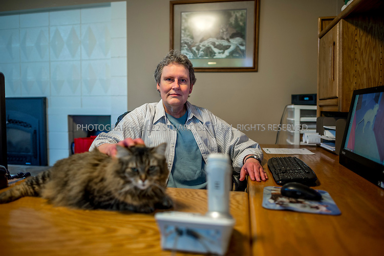 5/24/2015&mdash;Newcastle, WA<br /> <br /> SEC whistleblower Yolanda Holtzee, 59, in her home in Newcastle, WASH., near Seattle, which she shares with a roomate and six cats.<br /> <br /> Photograph by Stuart Isett for The Wall Street Journal.<br /> Slug: WHISTLEBLOWER