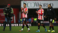 Brentford's Ollie Watkins, Said Benrahma and Bryan Mbeumo applaud the home fans at the final whistle during Brentford vs Queens Park Rangers, Sky Bet EFL Championship Football at Griffin Park on 11th January 2020
