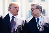 United States President Donald J. Trump talks to Attorney General William Barr during the 38th annual National Peace Officers' Memorial Service, at the U.S. Capitol in Washington, D.C. on May 15, 2019. <br /> Credit: Kevin Dietsch / Pool via CNP