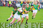 Na Gaeil's Maire Quirke gets away from Shannon Gaels Martina Hanley and Connie Doyle in the All Ireland Junior Club semi-final at Killeen on Sunday.