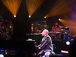 "Billy Joel performs ""Angry Young Man"" at the Key Arena in Seattle on November 8, 2007. Seattle was the 4th stop on a tour of 15 cities throughout Canada, United States and Mexico.  Jim Bryant Photo. ©2007. All Rights Reserved."