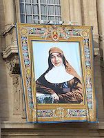 A tapestry depicting Australian Mary MacKillop hangs on the facade of Saint Peter's Basilica during a canonization mass in St. Peter's square, Vatican, 17 October 2010. The pope formally recognized Australia's first saint, Sister Mary MacKillop, who is revered as a pioneer of education in Outback Australia and the founder of the Sisters of St Joseph of the Sacred Heart. She was canonised along with Stanislaw Soltys of Poland, Andre Bessette of Canada, Candida Maria de Jesus Cipitria y Barriola of Spain, and Italians Giulia Salzano and Battista da Varano
