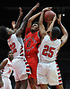 Jayson Delgado #0 of Floral Park, center, tries to drive inside the paint as Tah Jones #22, left, and Justin Meertens #25 of Freeport contest his shot during a non-league boys basketball game played at Nassau Coliseum in Uniondale on Tuesday, Dec. 4, 2018.