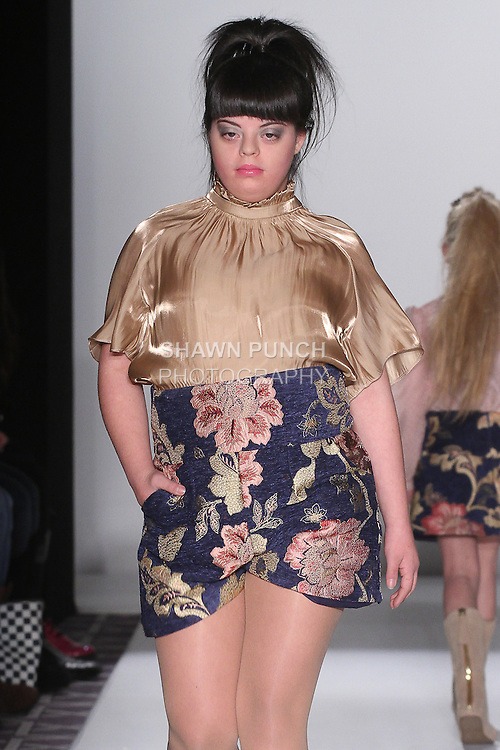 """Model walks runway in an outfit from the Michelle Ann Fall Winter 2016 """"Equestrian Chic"""" collection, at Fashion Gallery New York Fashion Week, during New York Fashion Week Fall 2016."""