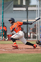 San Francisco Giants center fielder Heliot Ramos (31) follows through on his swing during an Instructional League game against the Kansas City Royals at the Giants Training Complex on October 17, 2017 in Scottsdale, Arizona. (Zachary Lucy/Four Seam Images)
