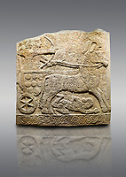 Picture &amp; image of Hittite relief sculpted orthostat stone panel of Long Wall Limestone, Karkamıs, (Kargamıs), Carchemish (Karkemish), 900 -700 B.C. Anatolian Civilisations Museum, Ankara, Turkey<br /> <br /> Chariot. One of the two figures in the chariot holds the horse's headstall while the other throws arrows. There is a naked enemy with an arrow in his hip lying face down under the horse's feet. It is thought that this figure is depicted smaller than the other figures since it is an enemy soldier. The lower part of the orthostat is decorated with braiding motifs.<br /> <br /> On a gray background.