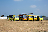 A fleet of school busses that was bought using Fairtrade Premiums that was given to the Fairtrade Cotton Farmers are parked in the Vasudha Vidya Vihar Karhi school compound in Khargone, Madhya Pradesh, India on 12 November 2014. Photo by Suzanne Lee for Fairtrade