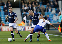 Steve Morison of Millwall gets the better of Maxime Colin of Birmingham City during the Sky Bet Championship match between Millwall and Birmingham City at The Den, London, England on 21 October 2017. Photo by Carlton Myrie.