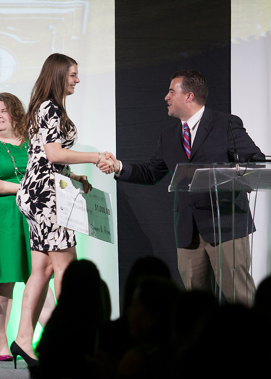 Pete Trentecoste, Executive Director of Housing & Residence Life, shakes hands with Ruby Williams who recieved a Division of Student Affairs Academic Excellence Scholarship at the 34th Annual Leadership Awards Gala in Baker Ballroom on Wednesday, April 5, 2017.