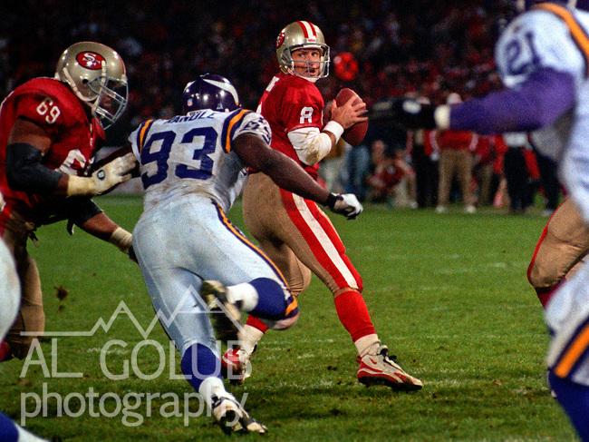 San Francisco 49ers vs. Minnesota Vikings at Candlestick Park Monday, December 18, 1995.  49ers beat Vikings  37-30.  Minnesota Vikings defensive tackle John Randle (93) rushes San Francisco 49ers quarterback Steve Young (8).