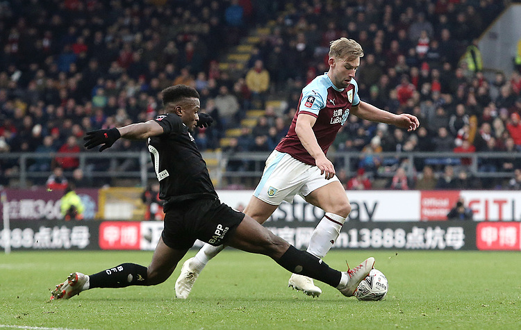 Burnley's Charlie Taylor is tackled by Barnsley's Dimitri Cavare<br /> <br /> Photographer Rich Linley/CameraSport<br /> <br /> Emirates FA Cup Third Round - Burnley v Barnsley - Saturday 5th January 2019 - Turf Moor - Burnley<br />  <br /> World Copyright © 2019 CameraSport. All rights reserved. 43 Linden Ave. Countesthorpe. Leicester. England. LE8 5PG - Tel: +44 (0) 116 277 4147 - admin@camerasport.com - www.camerasport.com