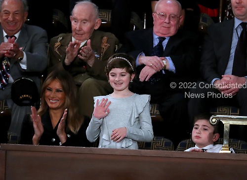Grace Eline, who was diagnosed with Germinoma, a germ-cell brain tumor, waves to the audience after being introduced by United States President Donald J. Trump during his second annual State of the Union Address to a joint session of the US Congress in the US Capitol in Washington, DC on Tuesday, February 5, 2019.  Grace recently finished chemotherapy and currently shows no evidence of the disease.  First lady Melania Trump applauds at left.  Joshua Trump, a sixth grader who was bullied at school because of his last name is pictured at right.<br /> Credit: Alex Edelman / CNP