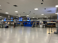 New York, New York City. New Yorkers are told to stay home during the corona virus, (COVID-19) so New York has become eerily empty. Penn Station. The Amtrak waiting area usually full of people, is empty.