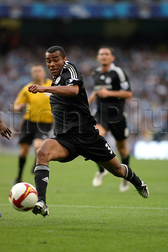 13 September 2008: Chelsea defender Ashley Cole runs with the ball during the Premier League game between Man City and Chelsea, played at The City of Manchester Stadium. Chelsea won the game 3-1 Photo: Action Plus..080913 soccer football player