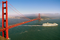 Golden Gate Bridge, San Francisco, California, USA - Cruise Ship passing under Bridge, City Skyline in Distance across San Francisco Bay