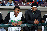 Dayton Dragons infielder Robert Ramirez #13 and pitcher Jesus Adames #37 before a game against the Bowling Green Hot Rods on April 20, 2013 at Fifth Third Field in Dayton, Ohio.  Dayton defeated Bowling Green 6-3.  (Mike Janes/Four Seam Images)