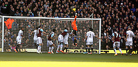 Pictured: Swansea goalkeeper Gerhard Tremmel (in orange) punches the ball away from a West Ham cross. 01 February 2014<br />