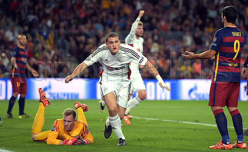 29.09.2015. Barcelona, Spain.  Leverkusen's Kyriakos Papadopoulos (C) celebrates after scoring the goal for 1:0 past arcelona's goalkeeper Marc-André ter Stegen (L) during the UEFA Champions League Group E first leg soccer match between FC Barcelona and Bayer 04 Leverkusen at the Camp Nou in Barcelona, Spain, 29 September 2015.