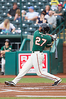 Felix Munoz (27) of the Greensboro Grasshoppers follows through on his swing against the Hagerstown Suns at NewBridge Bank Park on May 20, 2014 in Greensboro, North Carolina.  The Grasshoppers defeated the Suns 5-4. (Brian Westerholt/Four Seam Images)
