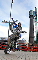21/02/'11 World Champion Street Bike Freestyle Rider, Mattie Griffin pictured on his BMW F800R this afternoon at Smithfield Square where he demonstrated some of his skills and stunts at the launch of the 'ZUP', the world's first motorcycle clothing connector system. ZUP allows riders to turn their favourite riding gear, leather into a suit by connecting trousers with jacket at the waist. The system was developed by two Irish bikers, Doreen Connaughton and Frank Mullen..Picture Colin Keegan, Collins, Dublin.